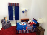 Blue pleated curtain with striped valance