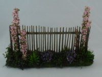 Fence w/ pink flower beds