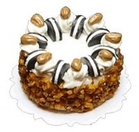 Cookie and nut topped cake