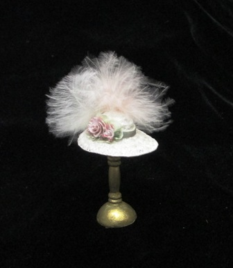 Pale pink hat w/feathers
